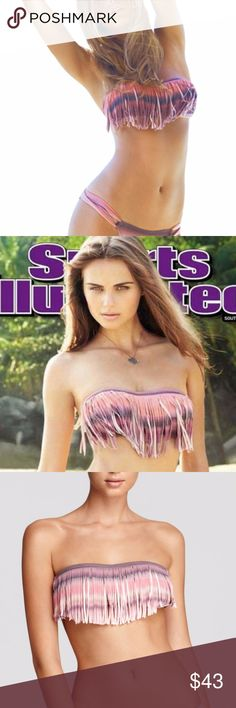 L*Space Santorini Sunrise Dolly Fringe Bandeau Top L*Space   Santorini Sunrise Dolly Fringe Bandeau Bikini Top  The L*Space Dolly Fringe Bandeau Bikini Top in Multi, as seen on the cover of Sports Illustrated South Africa Edition, is a summertime essential. There's something fashion-forward about L*Space's fringed bandeau Hinting at flirtatious but wholly feminine, this daring suit is destined to stun when you shimmy in the sun. Closure: Tie in back Material: 80% Nylon / 20% Spandex l*space…