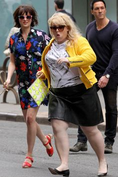 Dakota Johnson and Rebel Wilson make a dynamic duo as they were spotted running across the street on set of How to Be Single outside of Bloomingdales in New York City on May 18.