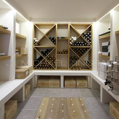 Modern wine cellar with under-the-rack shelving for large wooden wine crates