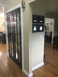 New coat closet. Painted french doors black using Behr Black Mocha and added mirrored film that reflects light and provides privacy