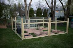 Fenced in raised garden beds