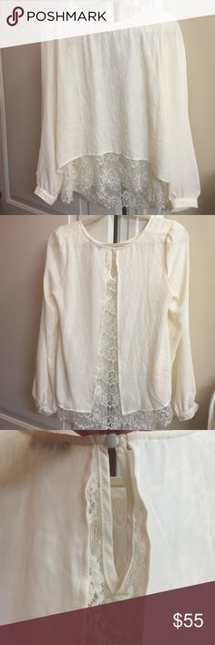 Gorgeous long sleeve cream blouse with lace under Gorgeous long sleeve cream/off white blouse with lace underlay. Back has beautiful opening and shows lace. Keyhole closure. Never worn. Comes with extra buttons Tops Blouses