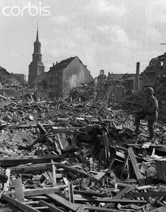 Reduced to rubble from frequent hammering by Allied bombers, the German town of Hamm, famous for its marshalling yards was captured by the U.S. 9th Army's 95th division. An American soldier surveys the ruins.
