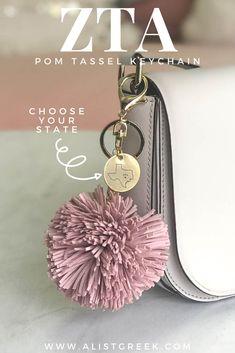 With a choice of 5 cute color options and 2 stylish engraved design options, this keychain will add the perfect ZTA style to your keys, backpack or tote. Shop starting at $28 www.alistgreek.com! #sorority#sororitylife #sororitysisters #tassel #pom #keychain#charm #biglittlegifts #gogreek #greeklife #sororitygifts #srat #greekletters #zta #zetataualpha #zeta
