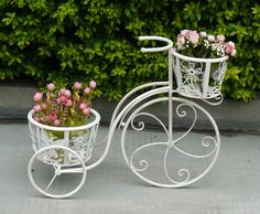 This white wrought iron planter would not only be a great decorative feature but also ideal for planting flowers, bulbs or herbs in any garden.