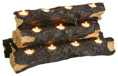 Sierra Tealight Fireplace Log - $79.99  The rustic charm of a flickering fire is re-created with this clever, hand-crafted resin log sculpture. Set it right in the fireplace for a no-fuss alternative to lighting a fire. Holds 11 tea lights (included).