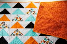 Triangle Baby Quilt from Cute + Delicious  Love the color combination, and triangles