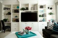 Living room with built-in bookshelves with space for TV