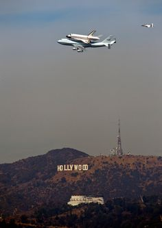 The Space Shuttle Endeavour atop a modified 747 passes the Hollywood Sign and the Griffith Observatory as seen from Dodger Stadium, Friday, Sept. in Los Angeles. Cosmos, Image Avion, Hollywood Sign, Hollywood California, Cali California, West Hollywood, Santa Monica, Air Space, Space Race