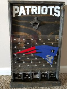 The perfect gift for any Patriots fan! Add a little fun and whimsy with the drinking version of the game Plinko. This will be a great addition to your bar, game room, or man cave! Item pictured is finished with Ebony stain and rustic bottle opener but also available in an oak, mahogany and walnut finish. Chrome bottle opener also available. Choose your stain and opener preference during checkout. Made with durable plexiglass and measures approximately 21 X 13. Two styles available: Without…