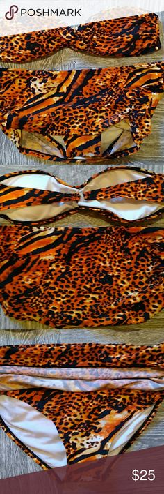 Retro leopard print bikini You will be the talk of the swim party with this awesome two piece. Shades of orange and black leopard print. Lightly padded top. Never has been worn. Both top and bottom are medium. Apollo Swim Bikinis