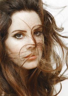 Lana Del Rey windblown look hair in her face makeup closeup