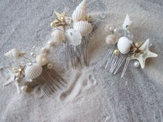 Wedding Hair Comb Bridal Natural Seashell and Starfish Hair Comb Headpiece with Pearls Crystals for Beach Weddings. $42,00, via Etsy.