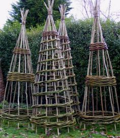 willow obelisks...I would love to make one of these for my garden..a functional piece of garden art!!..Inspiration!