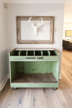 Antique luggage cart from Junk in the Trunk and deer head by Wall Charmers - as featured on 'Rafterhouse' pilot episode on HGTV.