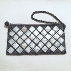 Gorgeous Handmade Mother of Pearl Clutch Wristlet Really beautiful handmade mother of pearl and beaded clutch. Great for an evening out to hold your ID, cash and some makeup. It measures 7 inches long by 4 inches high. Brand new and never been used. Comes from a smoke free and pet free home. No trades. *NOT from Zara, listing under brand for exposure.* Zara Bags Clutches & Wristlets