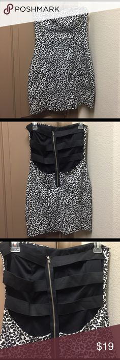 A'gaci Black/white leopard dress BNWT strapless Brand new with tags black and white leopard print strapless dress from a'gaci with tags. Bid a'gaci Dresses Mini