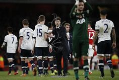 Tottenham Hotspur's Argentinian Head Coach Mauricio Pochettino (C) congratulates his team after the English Premier League football match between Arsenal and Tottenham Hotspur at the Emirates Stadium in London on November 8, 2015