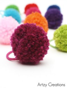 Pom Pom Ponytail Holder make a fun indoor summer activity. Tutorial by Artzy Creations.