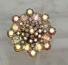 Vintage Signed Weiss Faceted Aurora Borealis Crystal Brooch ~ I need to find myself one!