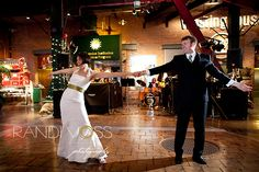 A bride and groom show off their moves to the sound of the City Heat Band at their reception, held at the Heinz History Center, Pittsburgh. Dressed in a beaded halter gown with a mermaid silhouette, the bride added a green sash for a splash of color - a clear indication of her big personality! http://www.cityheat.us/weddings.html