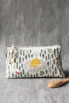 Retreat Large Cosmetic Bag - A large cosmetic bag made from 100% linen is perfect for storing your beauty essentials, accessories, toiletries and more. A cotton cord zipper is a nod to the cottage aesthetic, while it also keeps contents secure. A cozy cabin is nestled amongst toadstools and evergreens in a forest clearing, welcoming you to come inside and warm by the crackling fire. Large Cosmetic Bag, Cozy Cabin, Beauty Essentials, Zipper Pouch, Travel Style, Bag Making, Travel Bags, Coin Purse, Girly