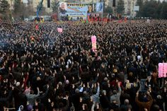 Kurdish people gather and flash the victory sign during a rally on January 27 in Diyarbakir, southeastern Turkey, following news that Kurdish fighters drove ISIS fighters from the Syrian border town of <span>Kobani</span>.
