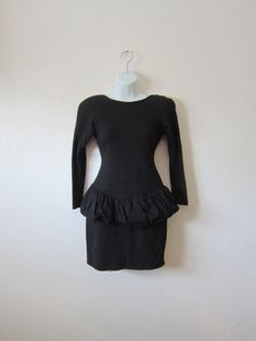 Hey, I found this really awesome Etsy listing at https://www.etsy.com/listing/243959716/vtg-black-dress-w-big-bow-fitted-sexy