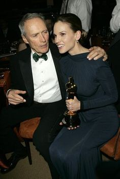 """The Academy Awards Ceremony """"Million Dollar Baby"""" Best Picture Oscar Best Director Oscar Clint Eastwood and Best Actress Oscar 2004 Clint Eastwood Hilary Swank catch up at the Governors Ball. Actor Clint Eastwood, Scott Eastwood, Best Director, Film Director, Oscar Photo, Divas, Best Actress Oscar, Oscar Winners, Star Wars"""