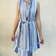 """Picnic Dress Perfect dress for a picnic! Blue and white vertical stripes. V-neckline. Waist tie. No size tag present but fits like a small. Approx.                measurements: Bust: 18"""" Length: 33"""".                      Make a reasonable offer via """"offer"""" button.        Discount on bundles!                                               No trades. Dresses"""