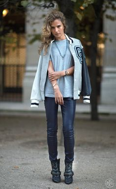 Fashion blogger Mia Knezevic was snapped by Adam Katz Sinding for the Tory Burch blog in this sporty looking outfit. She wears a slouchy grey t-shirt teamed with a letterman jacket, leather pants, and embroidered cowboy boots.