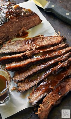 Beer Braised Beef Brisket | by Life Tastes Good is cooked low and slow for maximum deliciousness. The brisket is braised in stout beer that cooks down and leaves behind a deep, rich flavor that mingles nicely with the natural flavor of the beef. #LTGrecipes