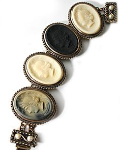 Extasia - cameo bracelet in our German glass cameos. cameo bracelet in our German glass cameos. This is a statement bracelet! Each cameo measures 1 1/2 by 1 inch. Overall length is 6 1/2 inches, for small to medium wrists. Bronze.  Cameo measures 1 1/2 by 1 inch, for small to medium wrists. Bronze.
