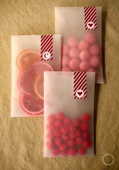 Translucent envelopes and washi tape and Valentine's Day candy wrapping