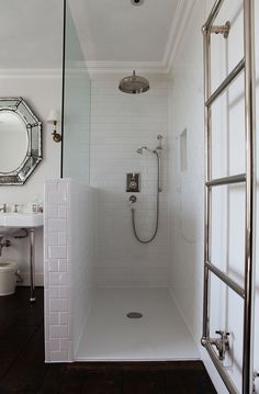 Open walk in shower, subway tiles, glass partition, towel rack