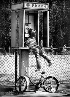 """""""Phone Booth"""" 1980's - Kids today cannot imagine a world without cell phones, without answering machines, and without texts. You could not instantly get in touch with each other, or leave a message if you missed someone from a pay phone."""
