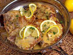 Pork Chops with Lemon Thyme Cream Sauce   bakeatmidnite.com   #porkchops #lemoncreamsauce #30minutemeals