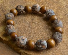 """GrayTibetan agate and wood beads. Bracelet fits 7.5"""" - 8"""" wrist. Customization available upon request.                                                                                                                                                                                 More"""