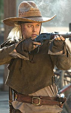 Armistice on Westworld.  Being burnt to a crisp and losing an arm can't even stop her.