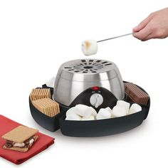 *The Indoor Flameless Marshmallow Roaster | The indoor roaster that produces campfire-worthy toasted marshmallows without an open flame. Marshmallows are toasted over a stainless steel electric heater, making it safe and easy to use with children. Ideal for creating s'mores year 'round, the included divided tray holds a ready supply of chocolate, graham crackers, or candies for your marshmallow creations.  #kitchen #gadgets