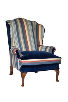 Fire side wing chair in Ralph Lauren with hand carved legs
