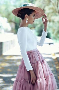 Hat, simple top, tulle skirt.