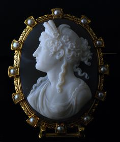A 19th century agate cameo of Ceres set in a gold mounting, enhanced with natural pearls and black enamel - French c.1860