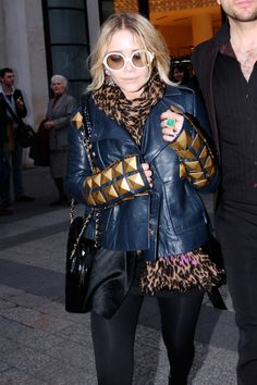 18 Fashion Don'ts The Olsen Twins Made Doable #refinery29  http://www.refinery29.com/2014/11/78667/olsen-twin-fashion-donts#slide-15  Choose one statement accessory. But who can choose? Certainly not Mary-Kate, whose blinding-white, oversized shades, multiple cocktail rings, oversized leopard scarf, and supersized studs attest.