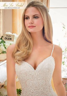 Dress Style OLEN  ALENCON LACE APPLIQUES ON TULLE WITH WIDE SCALLOPED HEMLINE.  Available in Three Lengths: 55, 58, 61. Colors Available: White, Ivory, Ivory/Champagne.