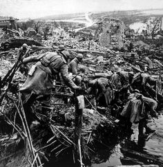 World War I, French soldiers searching in the ruins of a town in France, ca. 1918