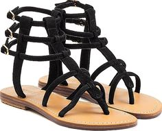 Mystique Women's Shoes in Black Color. Jet black suede and an intricate strappy silhouette insist these Mystique sandals are a smart investment for the summer months. Black suede, round open toe, thong front, buckle fastening ankle straps, leather insole and sole. Small, low heel. Pair with a brightly colored bikini