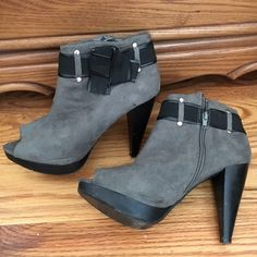 4.5 inch Heeled Peep-Toe Ankle Booties These Charlotte Russe ankle boots are equipped with an inside zipper and black knot on the outside. They are gray suede and have a slight platform with a 4.5 inch heel. Surprisingly very comfortable. Size 9 (I normally wear an 8.5-9.5 and these for great). Very slight wear and tear which can all be seen in the pics provided. Charlotte Russe Shoes Ankle Boots & Booties
