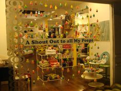 Window installation of garlands made with Peeps candies for Yolk, in a store in CA by Cathy of California