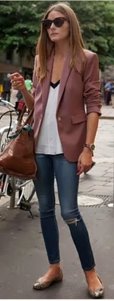 Olivia Palermo in Paris - cute drapey shirt with distressed skinnies. Fall outfit
